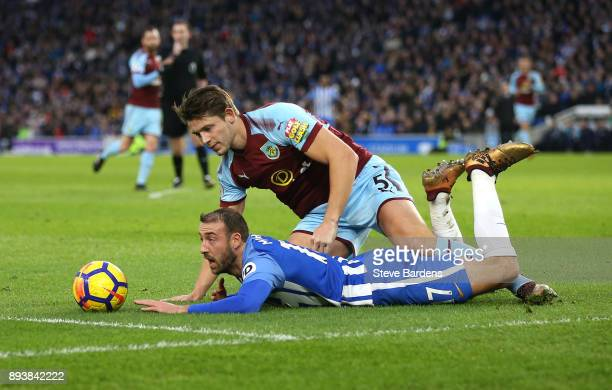 Glenn Murray of Brighton and Hove Albion is tackled by James Tarkowski of Burnley which leads to a penalty during the Premier League match between...