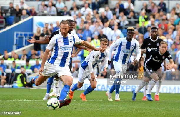 Glenn Murray of Brighton and Hove Albion scores a penalty for his team's second goal during the Premier League match between Brighton Hove Albion and...