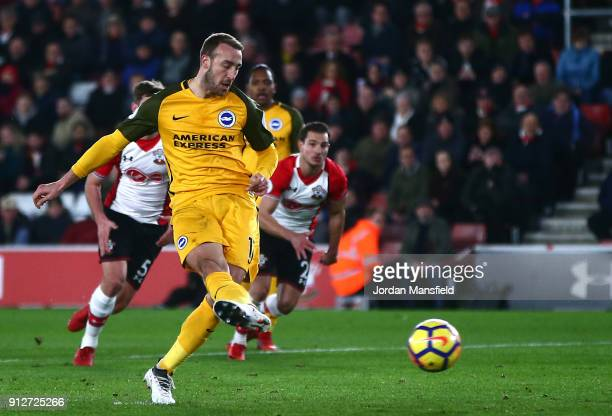 Glenn Murray of Brighton and Hove Albion scores his sides first goal during the Premier League match between Southampton and Brighton and Hove Albion...
