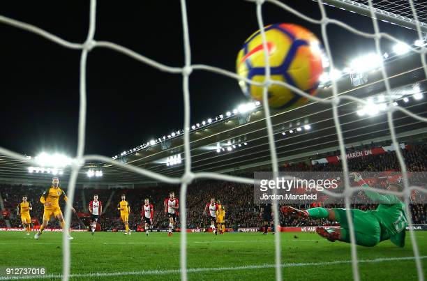 Glenn Murray of Brighton and Hove Albion scores his sides first goal from the penalty spot during the Premier League match between Southampton and...