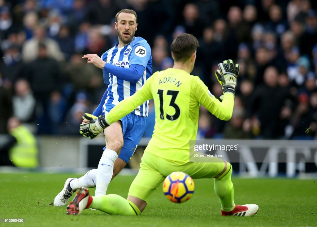 Glenn Murray of Brighton and Hove Albion scores his side's first goal past Adrian of West Ham United during the Premier League match between Brighton and Hove Albion and West Ham United at Amex Stadium on February 3, 2018 in Brighton, England.
