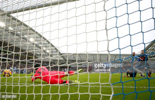 Glenn Murray of Brighton and Hove Albion scores his sides first goal during the Premier League match between Brighton and Hove Albion and Arsenal at...