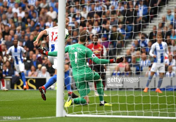 Glenn Murray of Brighton and Hove Albion scores his team's first goal during the Premier League match between Brighton Hove Albion and Manchester...