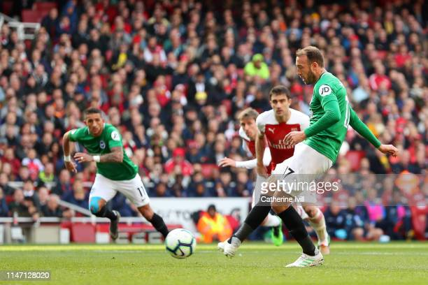 Glenn Murray of Brighton and Hove Albion scores his team's first goal from the penalty spot during the Premier League match between Arsenal FC and...