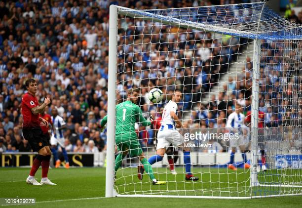 Glenn Murray of Brighton and Hove Albion shoots and scores his side's first goal during the Premier League match between Brighton Hove Albion and...