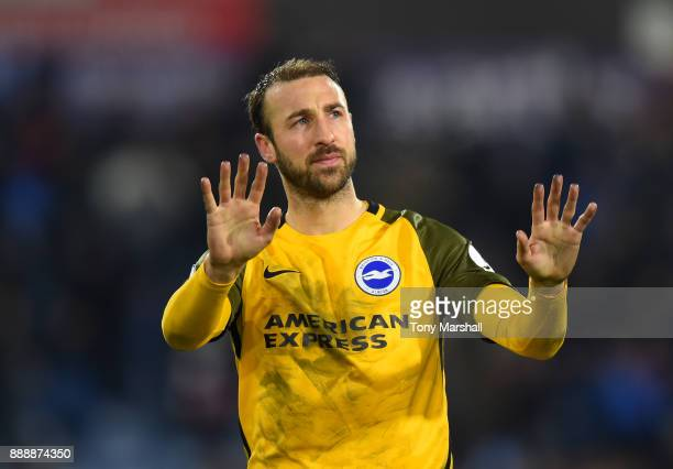 Glenn Murray of Brighton and Hove Albion shows appreciation to the fans after the Premier League match between Huddersfield Town and Brighton and...