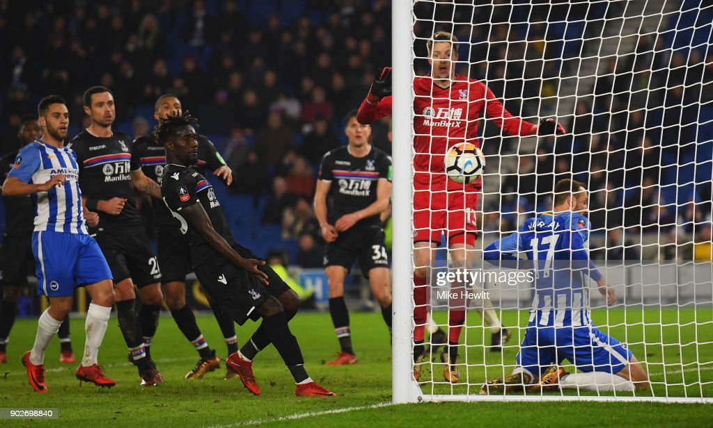 Glenn Murray of Brighton and Hove Albion (17) slides into the net as he scores their second goal during The Emirates FA Cup Third Round match between Brighton & Hove Albion and Crystal Palace at Amex Stadium on January 8, 2018 in Brighton, England.