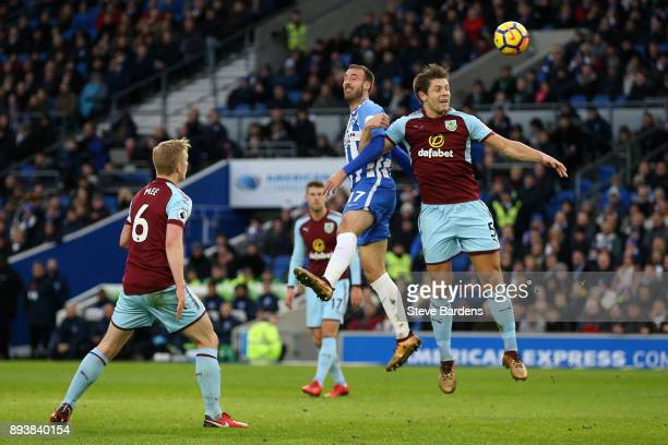 Glenn Murray of Brighton and Hove Albion wins a header over James Tarkowski of Burnley during the Premier League match between Brighton and Hove...