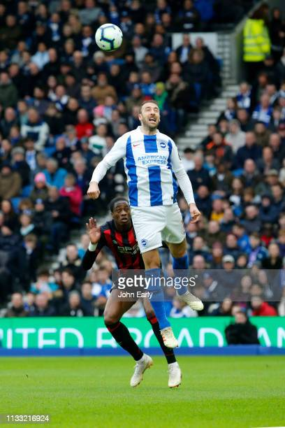 Glenn Murray of Brighton Hove Albion and Terence Kongolo of Huddersfield Town during the Premier League match between Brighton Hove Albion and...