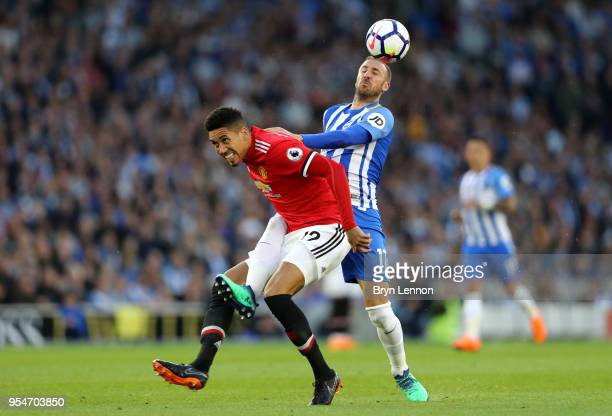 Glenn Murray of Brighton Hove Albion battles for the ball with Chris Smalling of Manchester United during the Premier League match between Brighton...