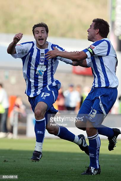 Glenn Murray of Brighton & Hove Albion celebrates with team mate Adam Virgo after scoring his sides 2nd goal during the Coca Cola League One Match...