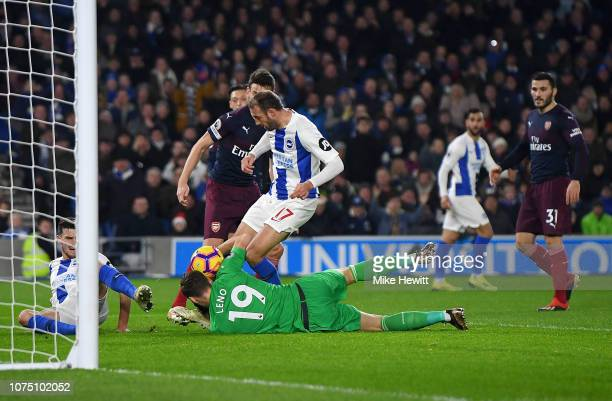 Glenn Murray of Brighton Hove Albion is challenged by Bernd Leno of Arsenal during the Premier League match between Brighton Hove Albion and Arsenal...