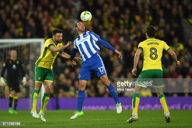 Glenn Murray of Brighton is challenged by Russell Martin and Jonny Howson of Norwich during the Sky Bet Championship match between Norwich City and...
