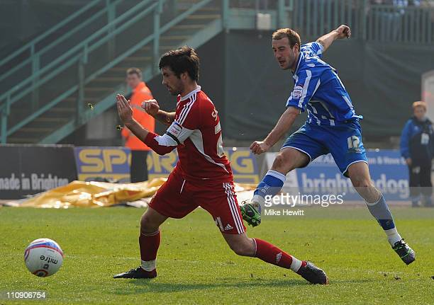 Glenn Murray of Brighton scores despite the efforts of Alan Sheehan of Swindon during the npower League One match between Brighton & Hove Albion and...