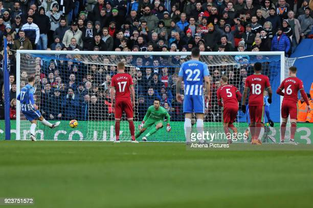 Glenn Murray of Brighton scores from the penalty spot against Lukasz Fabianski of Swansea City during the Premier League match between Brighton and...