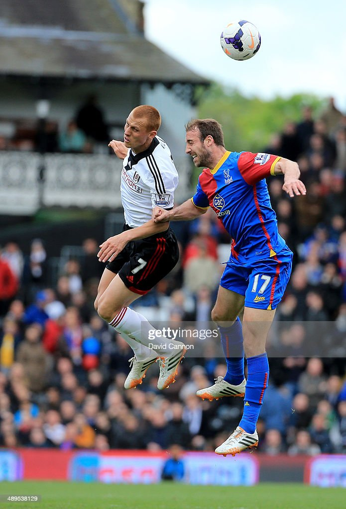 Glenn Murray of Crystal Palace and Steve Sidwell of Fulham clash during the Barclays Premier League match between Fulham and Crystal Palace at Craven Cottage on May 11, 2014 in London, England.