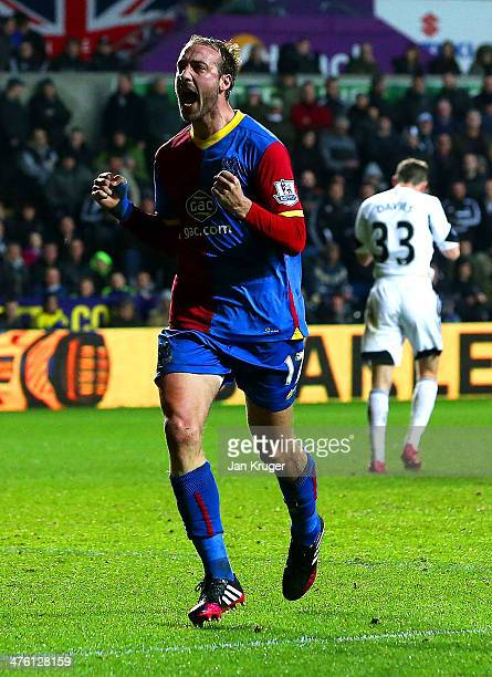 Glenn Murray of Crystal Palace celebrates scoring the equalising goal from the penalty spot during the Barclays Premier League match between Swansea...