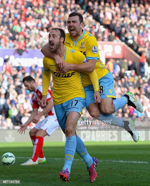 Glenn Murray of Crystal Palace celebrates scoring their first goal from the penalty spor with James McArthur of Crystal Palace during the Barclays...