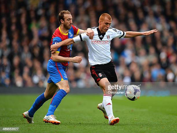 Glenn Murray of Crystal Palace closes down Steve Sidwell of Fulham during the Barclays Premier League match between Fulham and Crystal Palace at...