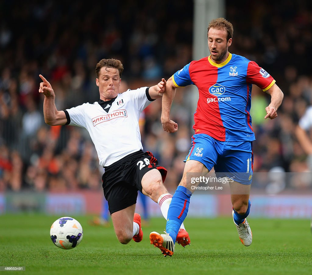 Glenn Murray of Crystal Palace is tackled by Scott Parker of Fulham during the Barclays Premier League match between Fulham and Crystal Palace at Craven Cottage on May 11, 2014 in London, England.