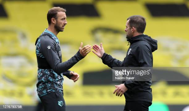Glenn Murray of Watford shakes hands with Nathan Jones Manager of Luton Town after the Sky Bet Championship match between Watford and Luton Town at...