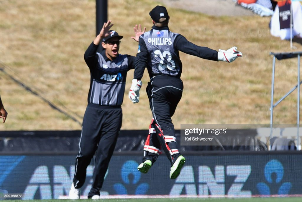 Glenn Phillips of New Zealand (R) is congratulated by Ross Taylor of New Zealand after taking a catch to dismiss Chris Gayle of the West Indies during game one of the Twenty20 series between New Zealand and the West Indies at Saxton Field on December 29, 2017 in Nelson, New Zealand.