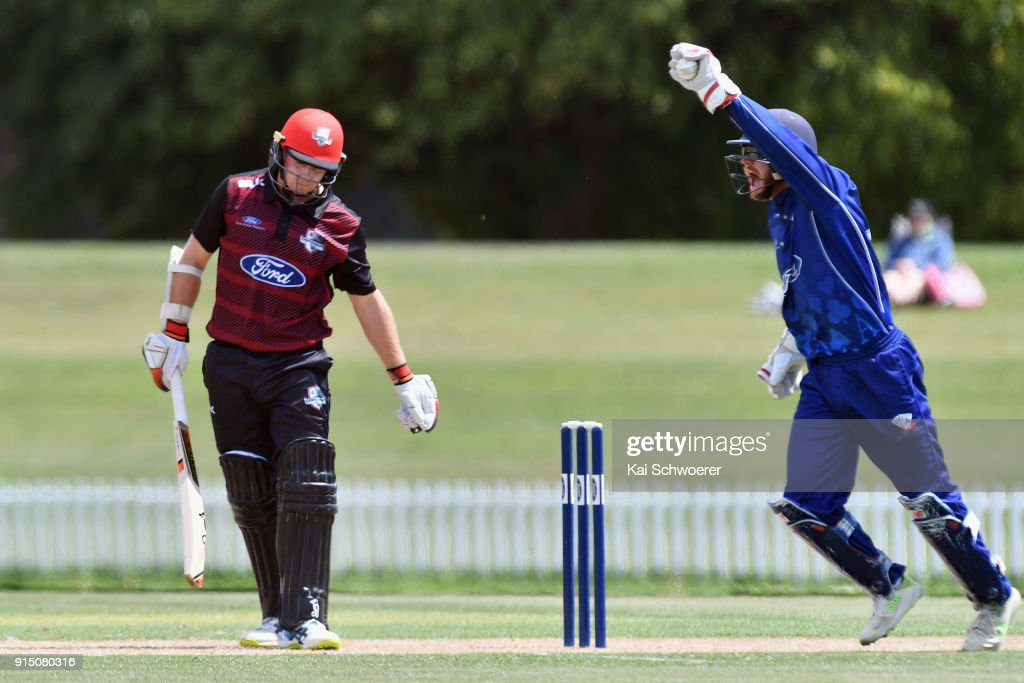 Glenn Phillips of the Auckland Aces celebrates after taking a catch to dismiss Tom Latham of Canterbury (L) during the One Day Ford Trophy Cup match between Canterbury and Auckland on February 7, 2018 in Christchurch, New Zealand.