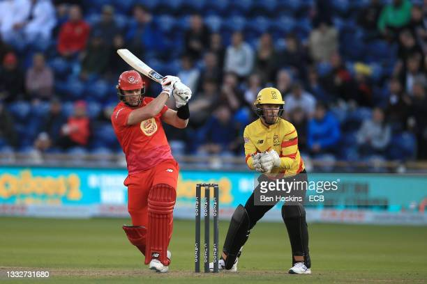 Glenn Phillips of Welsh Fire bats as Tom Moores of Trent Rockets looks on during The Hundred match between Welsh Fire Men and Trent Rockets Men at...