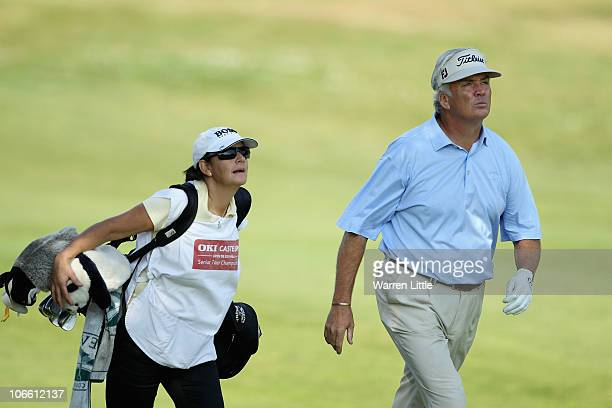 Glenn Ralph of England strides up the eighth fairway with his wife and caddie Michele Ralph during the final round of the OKI Castellon Senior Tour...