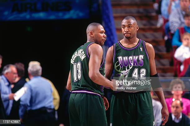 Glenn Robinson and Vin Baker of the Milwaukee Bucks wait to resume play against the Sacramento Kings during a game played on March 13 1996 at the...