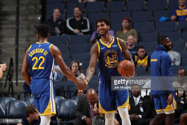 Glenn Robinson III and Marquese Chriss of the Golden State Warriors hifive each other against the Memphis Grizzlies on November 19 2019 at FedExForum...