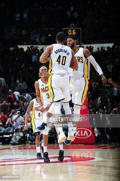 Glenn Robinson III celebrates hitting the game winning shot with Paul George of the Indiana Pacers against the Atlanta Hawks on March 5 2017 at...