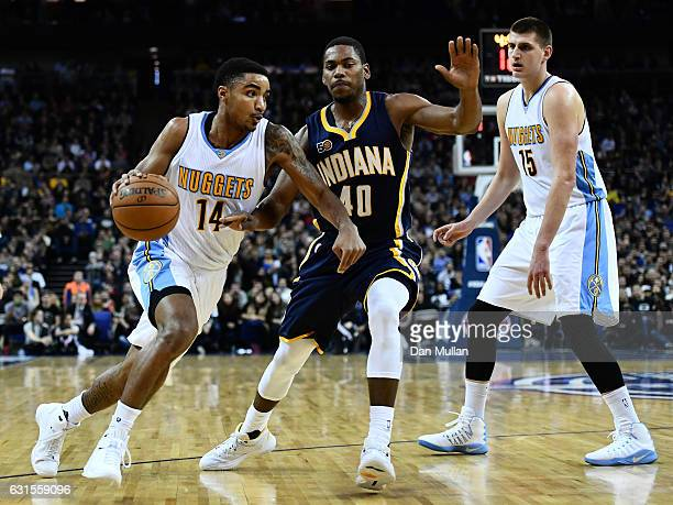 Glenn Robinson III of the Indiana Pacers holds off Gary Harris of the Denver Nuggets during the NBA match between Indiana Pacers and Denver Nuggets...