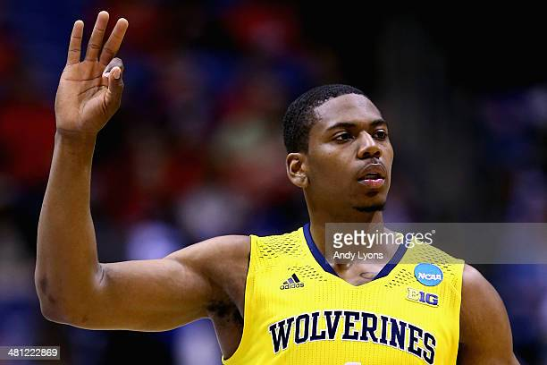 Glenn Robinson III of the Michigan Wolverines celebrates a three pointer in the first half against the Tennessee Volunteers during the regional...