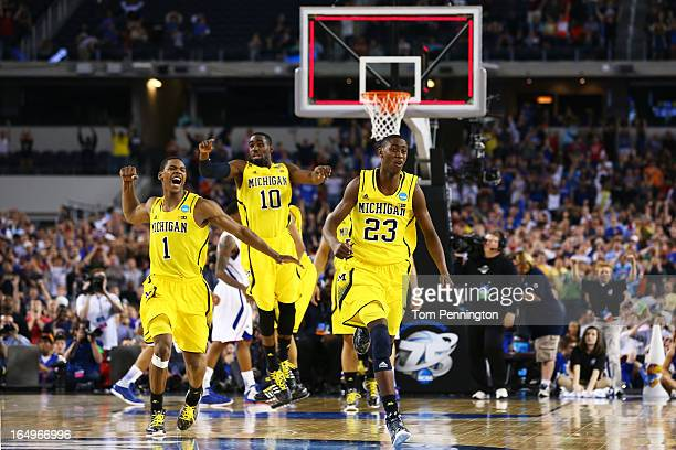 Glenn Robinson III Tim Hardaway Jr #10 and Caris LeVert of the Michigan Wolverines celebrate their 87 to 85 win over the Kansas Jayhawks in overtime...