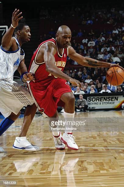 Glenn Robinson of the Atlanta Hawks drives against Tracy McGrady of the Orlando Magic during the NBA game at TD Waterhouse Centre on November 30 2002...