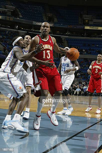 Glenn Robinson of the Atlanta Hawks drives to the basket against Ricky Davis of the Cleveland Cavaliers during the game at Gund Arena on March 5 2003...