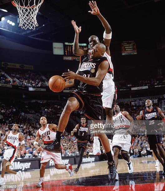 Glenn Robinson of the Philadelphia 76ers drives to the basket against Zach Randolph of the Portland Trail Blazer at Rose Garden on November 3 2003 in...