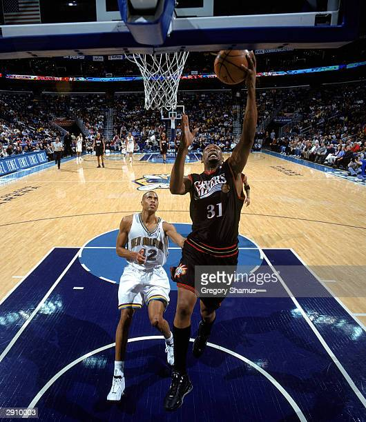 Glenn Robinson of the Philadelphia 76ers goes for a layup during the NBA game against the New Orleans Hornets at New Orleans Arena on January 21 2004...