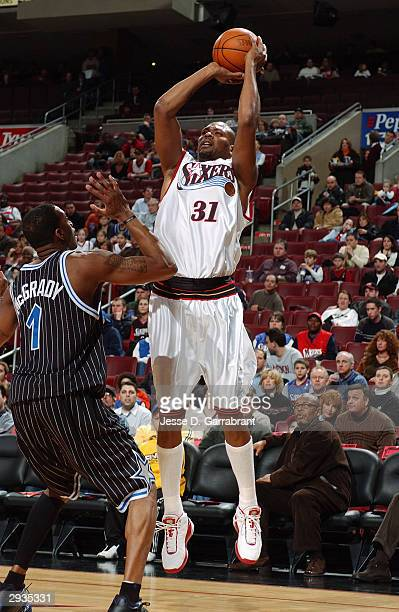 Glenn Robinson of the Philadelphia 76ers shoots a jump shot over Tracy McGrady of the Orlando Magic during the game at Wachovia Center on January 23...
