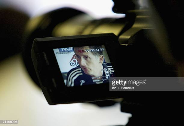 Glenn Roeder is seen in a television camera viewfinder as he attends a press conference before the Newcastle United training session prior to the...