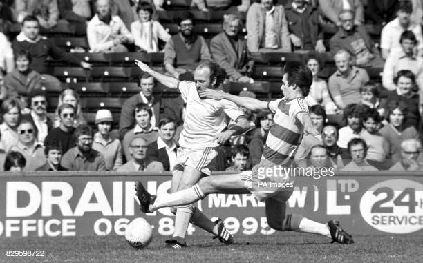 Glenn Roeder of QPR lunges in to stop Archie Gemmill of Birmingham City