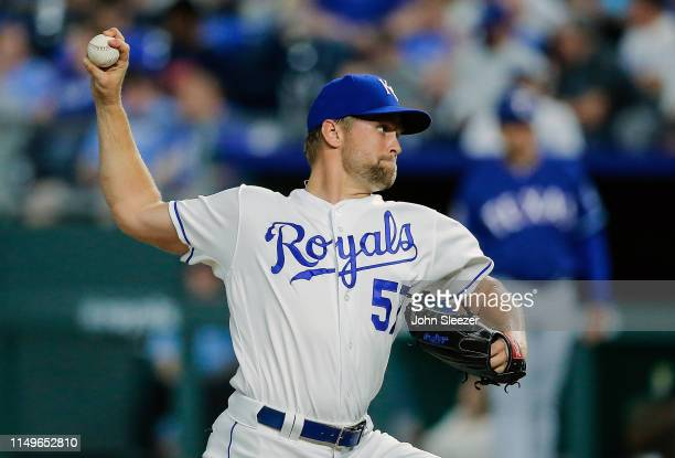 Glenn Sparkman of the Kansas City Royals throws in the seventh inning during the game against the Texas Rangers at Kauffman Stadium on May 15 2019 in...