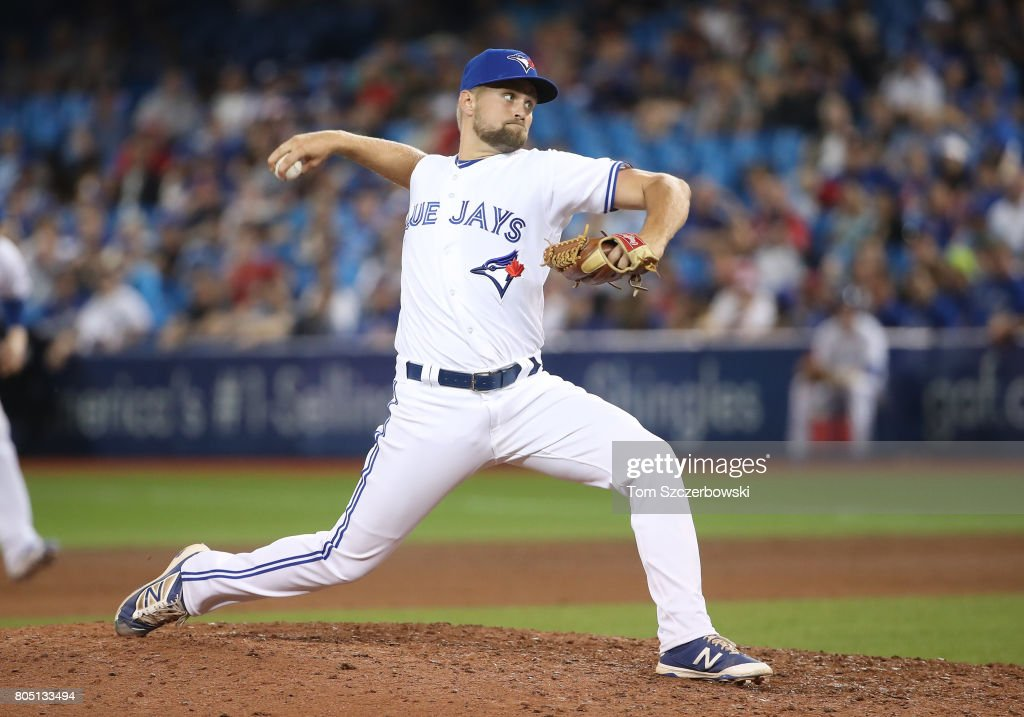 Glenn Sparkman #46 of the Toronto Blue Jays delivers a pitch in the eleventh inning during MLB game action against the Boston Red Sox at Rogers Centre on June 30, 2017 in Toronto, Canada.