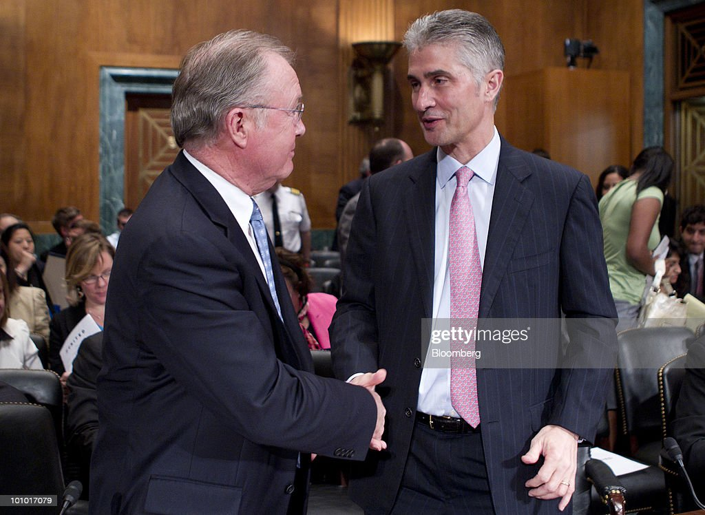 Glenn Tilton, chairman, president and chief executive officer of United Airlines, left, and Jeffery Smisek, chairman, president and chief executive officer of Continental Airlines Inc., shake hands following an Antitrust, Competition Policy and Consumer Rights Subcommittee hearing on the proposed merger between United Airlines and Continental Airlines Inc. in Washington, D.C., U.S., on Thursday, May 27, 2010. United Airlines' proposed merger with Continental Airlines won't cut competition because discount carriers can begin service and win passengers, the chief executives of the two companies told a Senate antitrust panel. Photographer: Andrew Harrer/Bloomberg via Getty Images