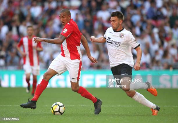 Glenn Walker of Brackley Town is chased by Josh Rees of Bromley during the Buildbase FA Trophy Final between Brackley Town and Bromley FC at Wembley...