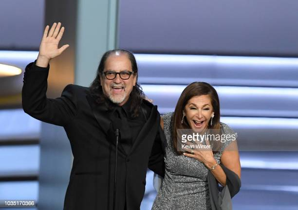 Glenn Weiss winner of the Outstanding Directing for a Variety Special award for 'The Oscars' and Jan Svendsen react after getting engaged onstage...