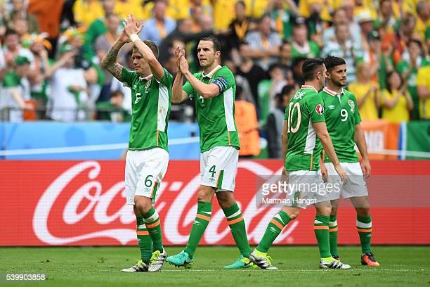 Glenn Whelan John O'Shea Robbie Keane and Shane Long of Republic of Ireland react after their 11 draw in the UEFA EURO 2016 Group E match between...
