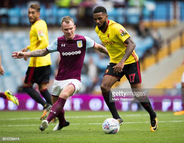 Glenn Whelan of Aston Villa and Jerome Sinclair of Watford during the pre season friendly match between Aston Villa and Watford at Villa Park on July...