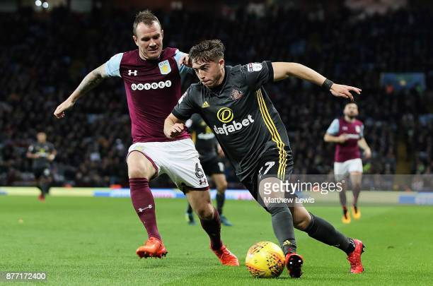 Glenn Whelan of Aston Villa and Lynden Gooch of Sunderland challenge for the ball during the Sky Bet Championship match between Aston Villa and...